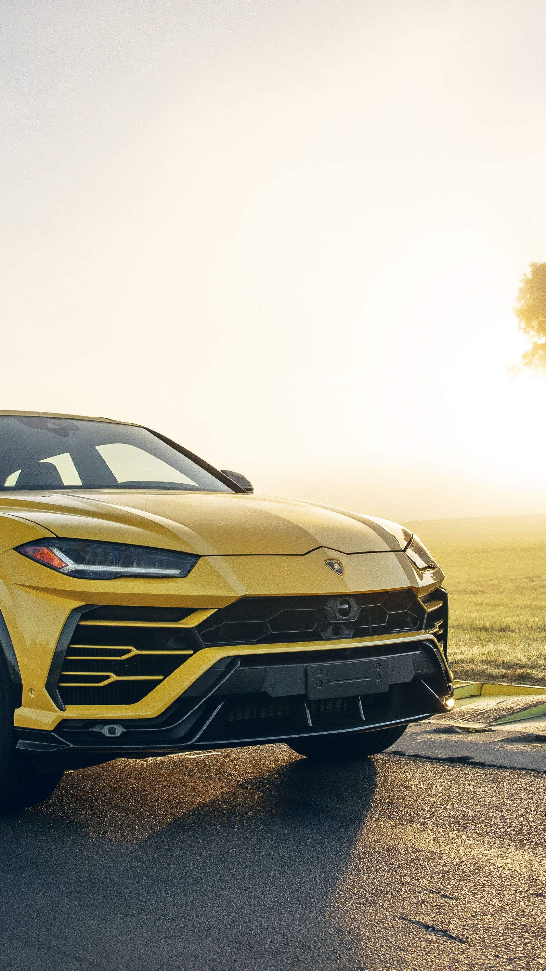 2160x3840 Car Yellow Lamborghini Urus Compact Car Wallpaper