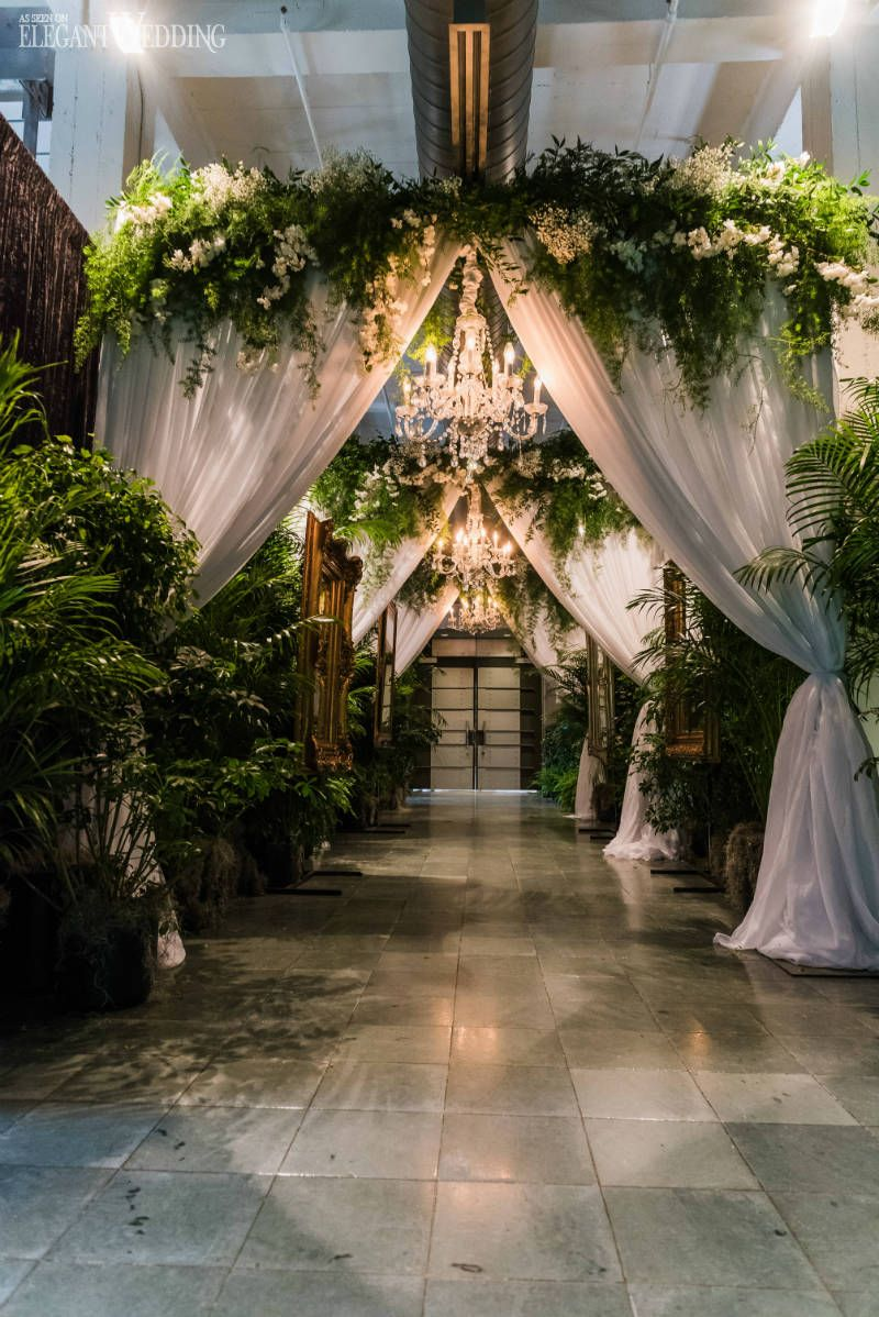 A Garden Party Wedding Covered In Greenery Chandelier Wedding
