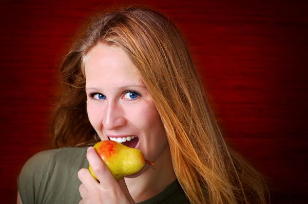 woman-eating-pear-as-snack