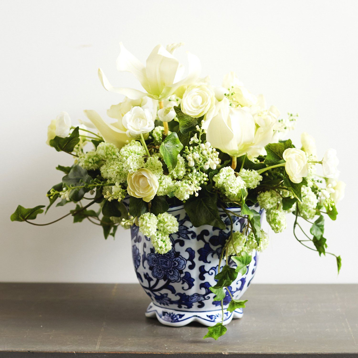 Cream Ranunculus Orchid Green Snowball Everyday Floral Arrangement In Blue And White Chinoiserie Jardiniere Pot White Flower Arrangements Spring Floral Arrangements Floral Arrangements