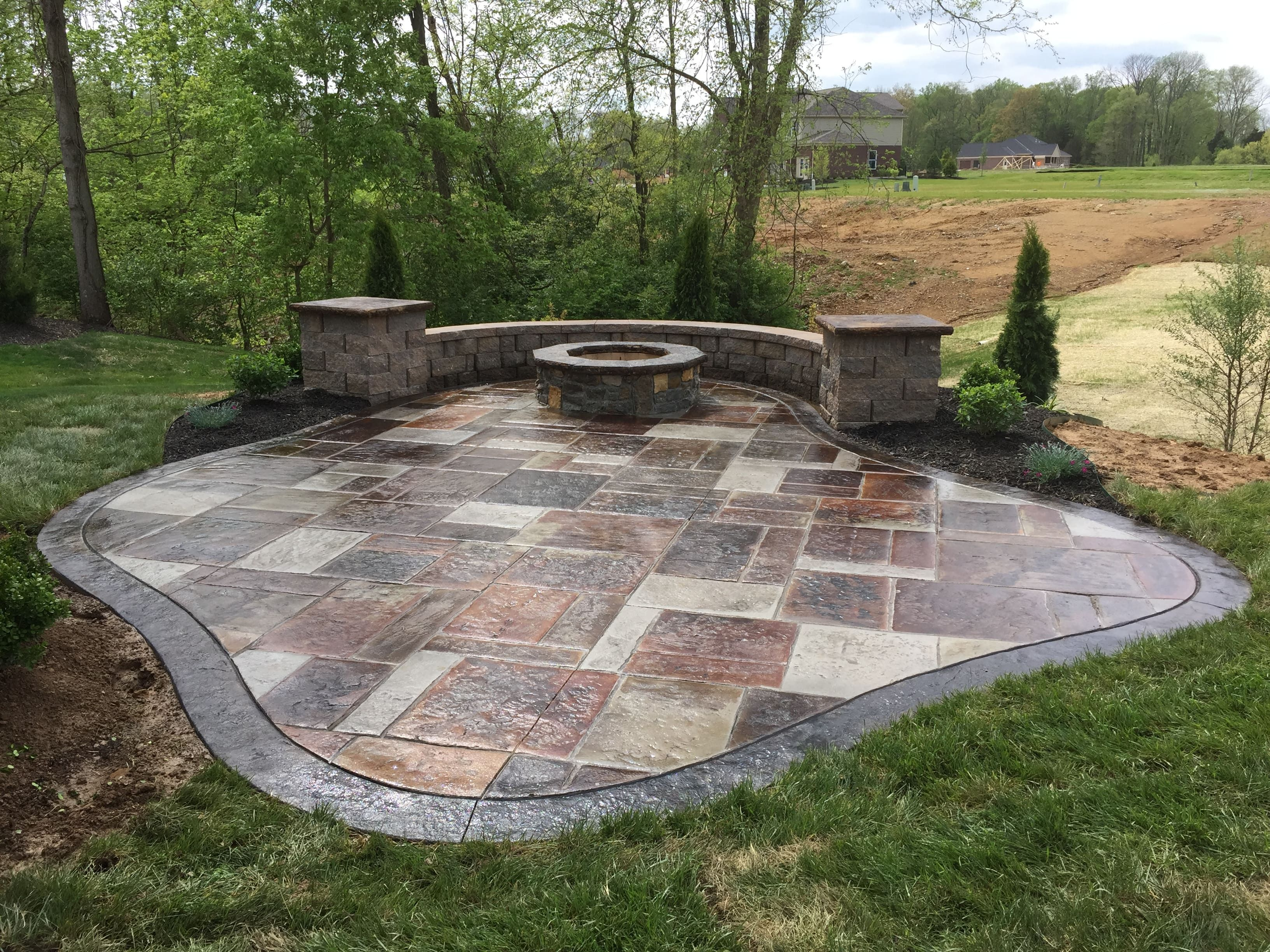 Decorative Concrete Patio With Seating Wall Columns And Fire Pit Cincinnati Ohi Stamped Concrete Patio Decorative Concrete Patio Decorative Concrete Driveways
