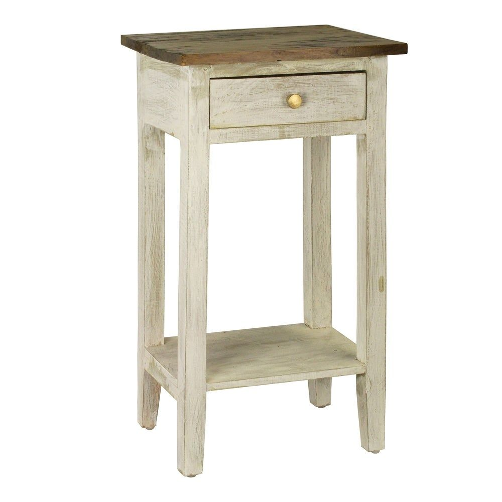Introduce additional storage in any room with this elegant wooden side table. Tall enough for use as a bedside table or even a living room side table, this piece features a single drawer for convenient storage and a single shelf for stashing larger items such as photographs, books, or keepsakes. Crafted of mahogany and brass Distressed finish Available in white, blue and green Materials: Mahogany, brass Dimensions: 27.56 inches high x 15.7 inches width x 11.8 inches depth