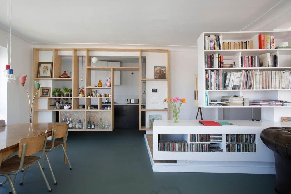 Architect creëert open woonkamer met terras van appartement die twee ...