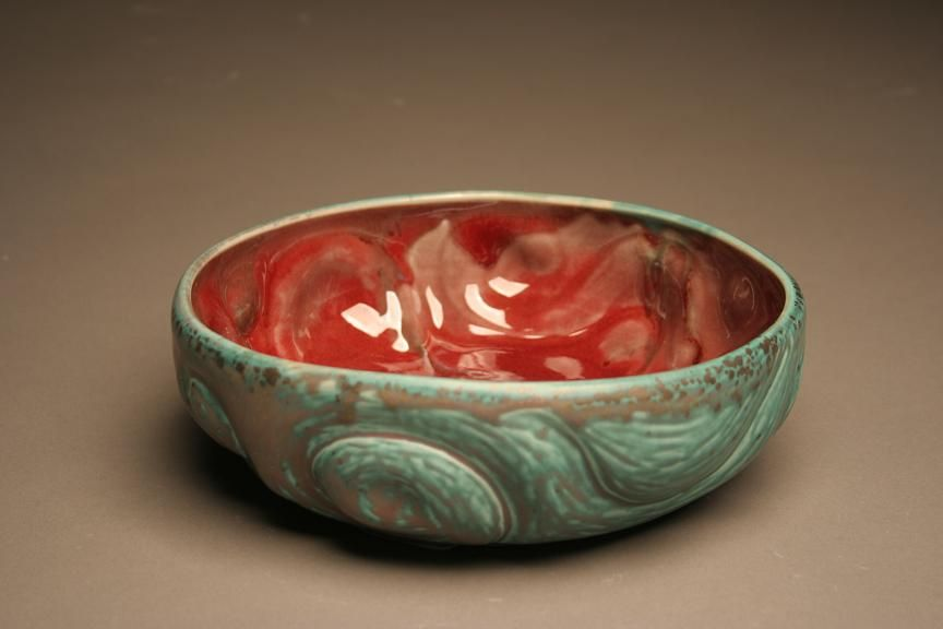 Green Passion Bowl at $75. An undulating bowl of rich red interior, this bronze green serving dish is thrown and altered white stoneware clay fired in a reduction atmosphere.