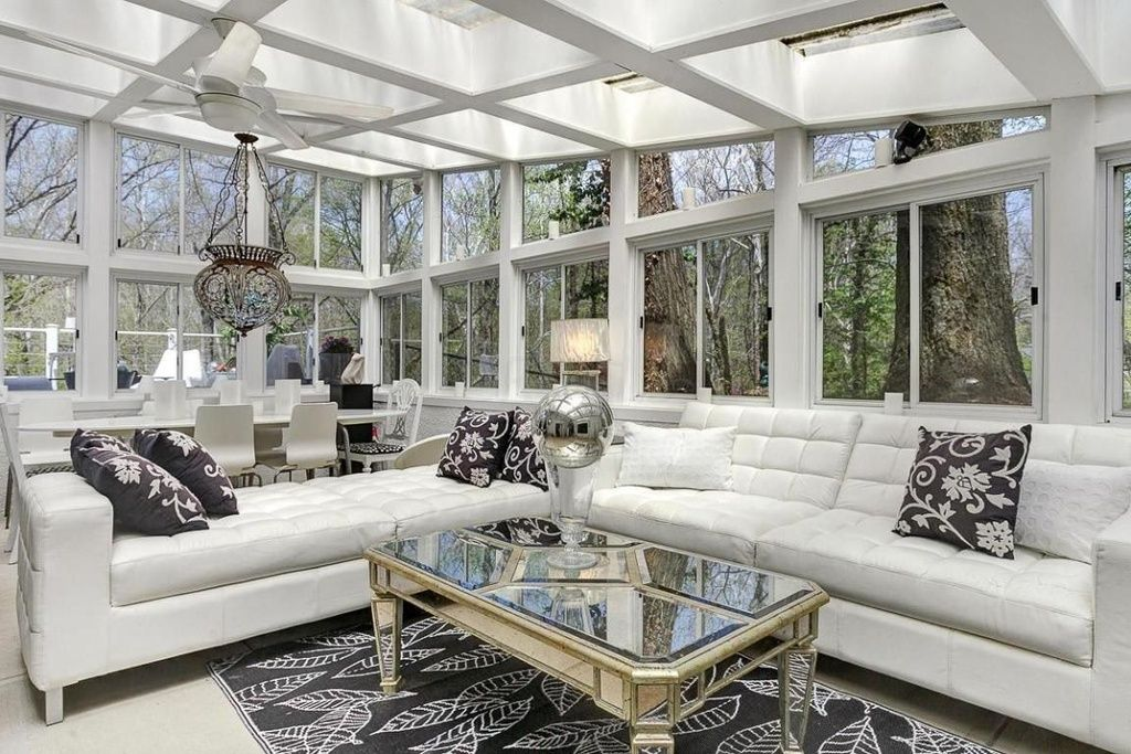 Contemporary Living Room With Leather Couch Sun Porch Tufted Sofa Angled Ceiling