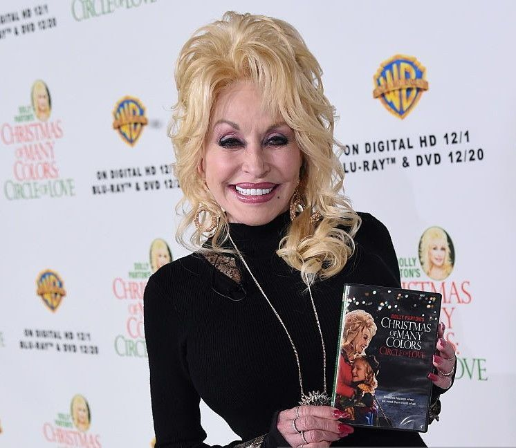 Dolly parton promotes the release of christmas of many