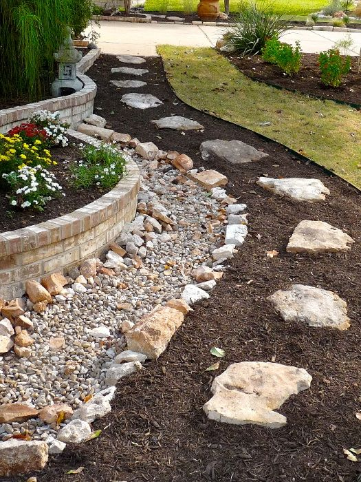 Dry Riverbed For Downspout Drainage And A Pathway
