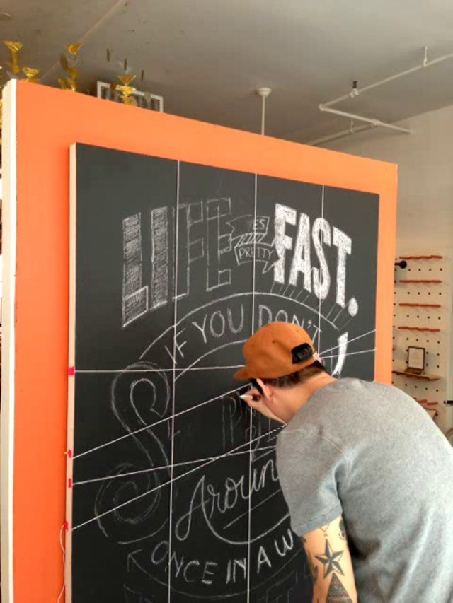 Brilliant! Use string to mark your grid for chalkboard lettering so you don't have to erase it later! (Friends of Type mural for the 2012 Etsy Holiday Shop.)