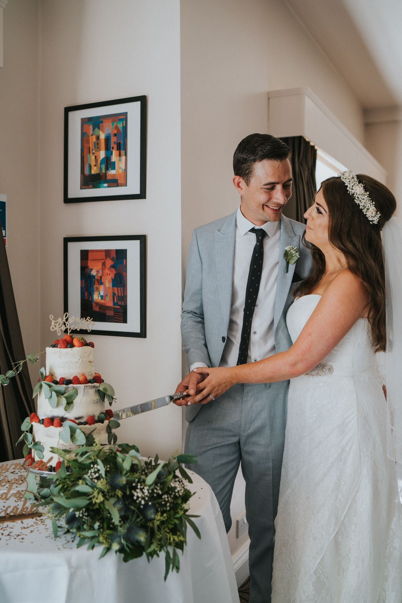 Beautifully romantic wedding on a diy budget cutting the wedding