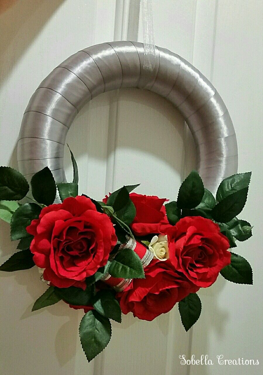 Hand-made floral Christmas wreath. Red silk roses with silver ...