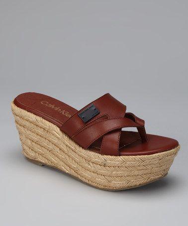 e9584c71bcc Take a look at this Cognac Cori Platform Sandal by Calvin Klein ...