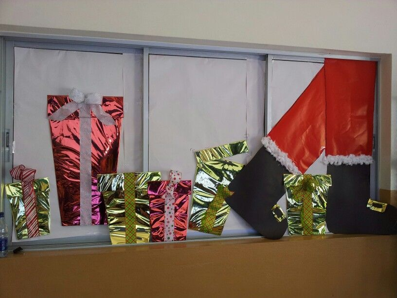 Santa Clause and gifts on my classroom windows.--do this on the patio doors