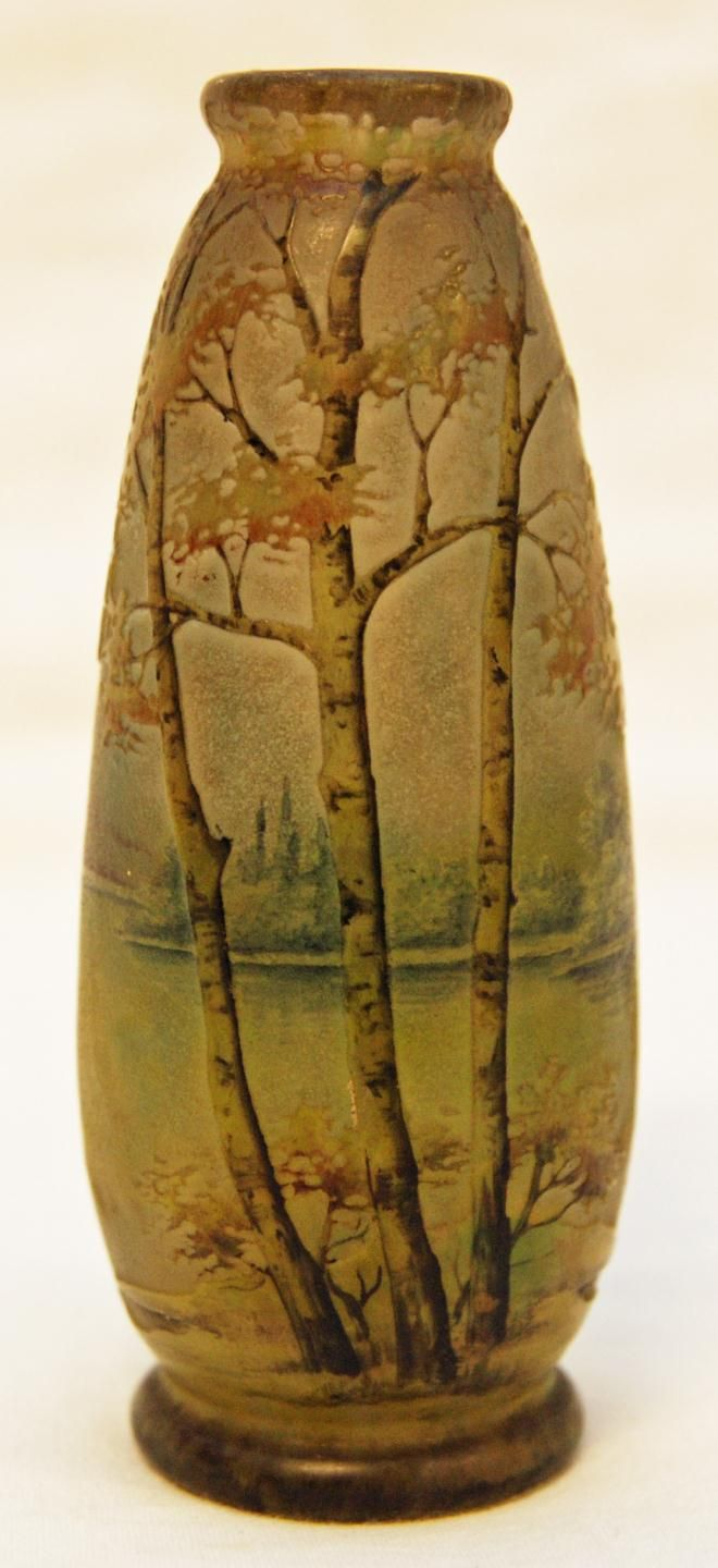 Cameo art glass vase depicting a forest scene over green background.