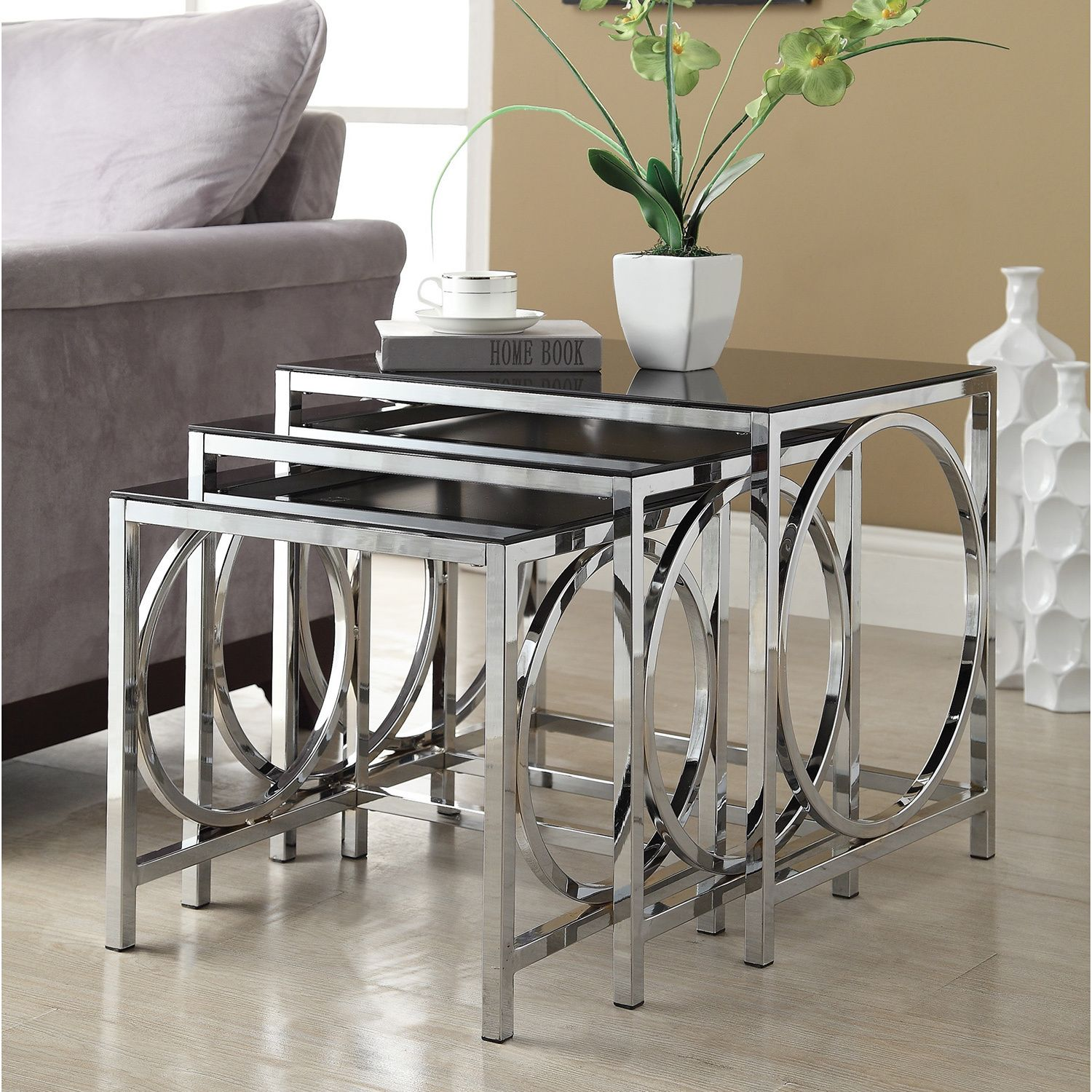 This functional set of three nesting tables have a beautiful chrome ...