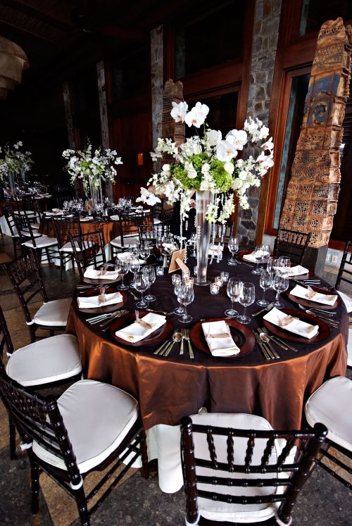 Elegant brown and white tablescapes with statement orchid and rose centrepieces were the perfect balance between classic and modern at this @Mandy Dewey Seasons Resort Costa Rica affair.