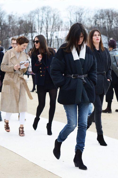 Capucine Safyurtlu in a navy blue blazer + black mini dress + black opaque tights + black ankle boots and Emmanuelle Alt in a black belted coat + skinny jeans + black ankle boots