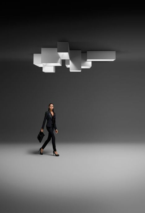 From Ramon Esteve, a modular ceiling lighting system for Vibia that mimics daylight seen through a skylight.