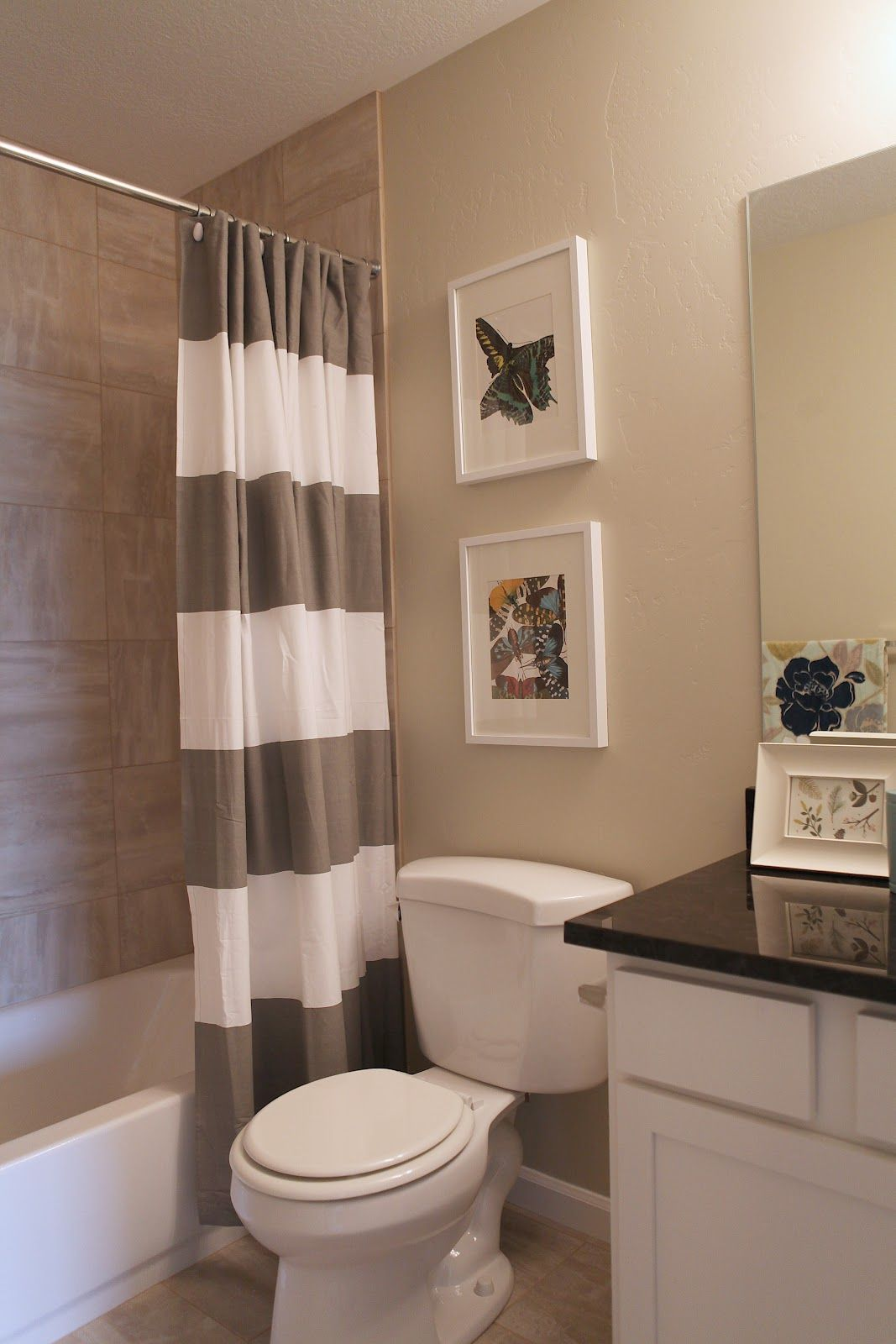 i like the linen look tiles in the bath surround goes well with paint color and white tub. Black Bedroom Furniture Sets. Home Design Ideas