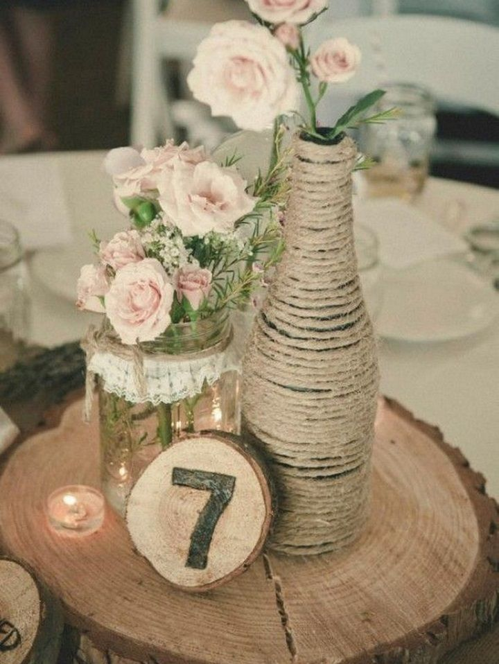 Mason jar on wooden slice rustic wedding centerpiece #weddingcenterpieces #centerpieces #rusticwedding