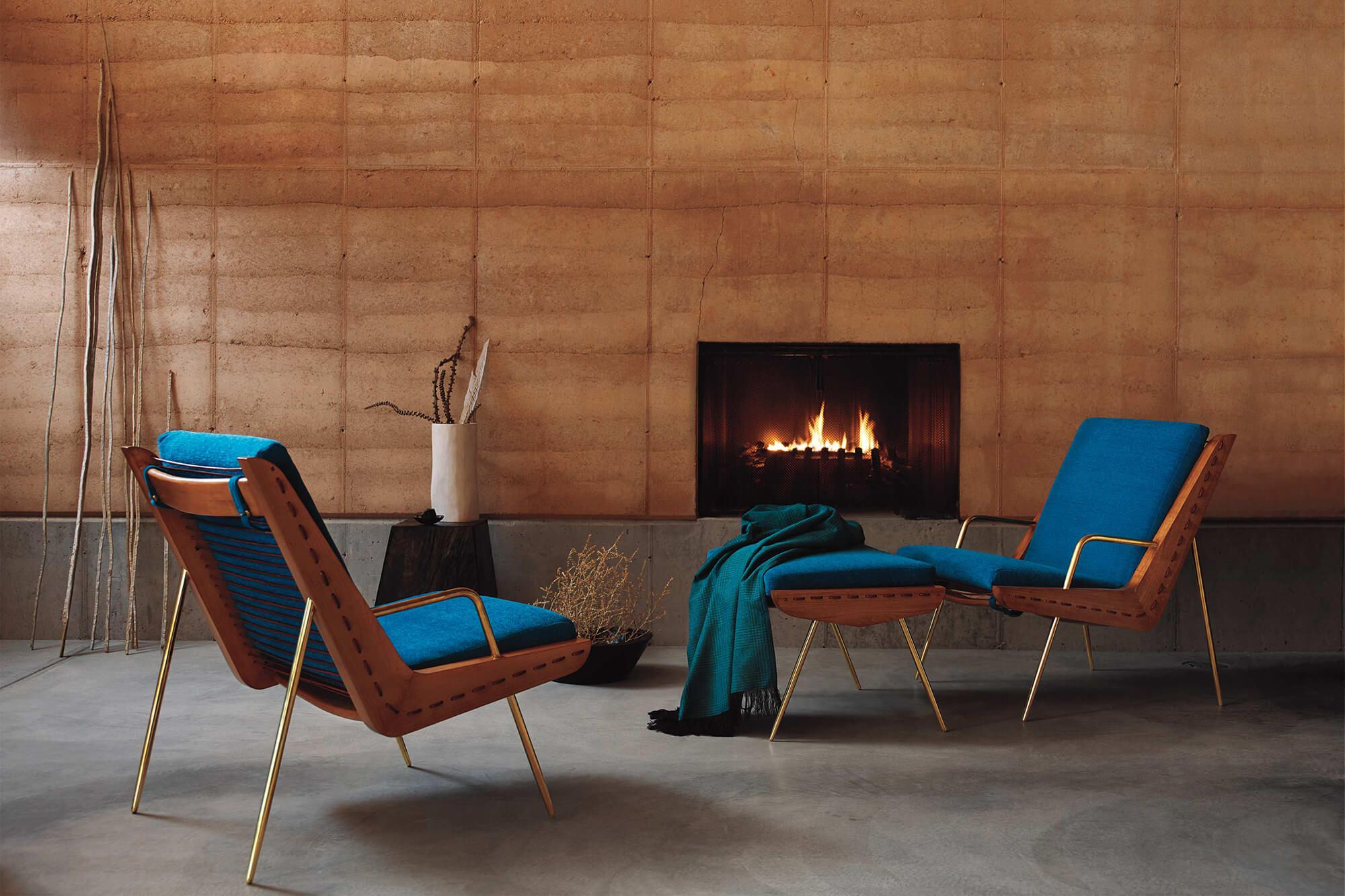 Chairs Upholstered In Teal Sunbrella Fabric Sit In Front Of A Fireplace