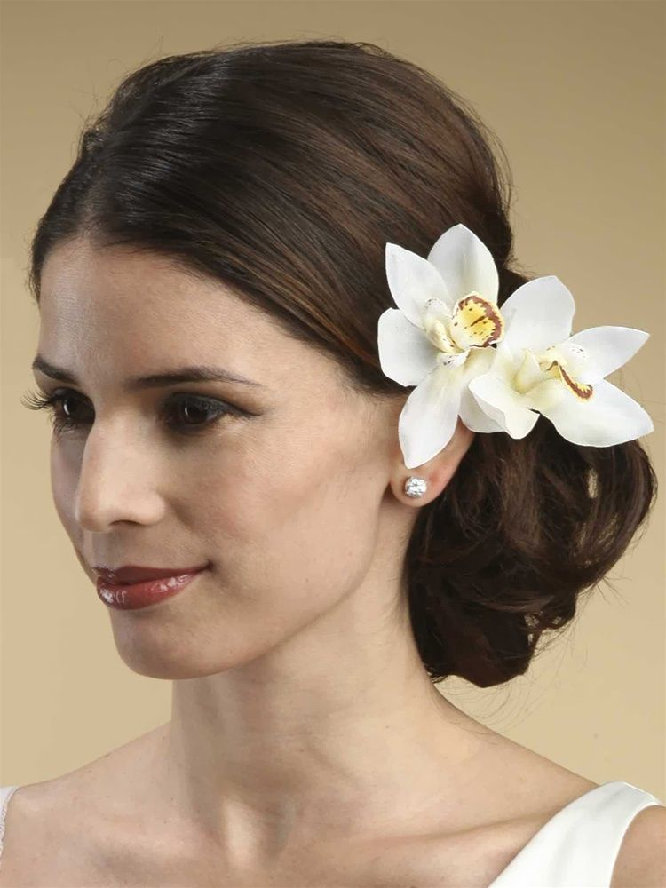 Orchids look beautiful in wedding hairstyle Hairstyle with