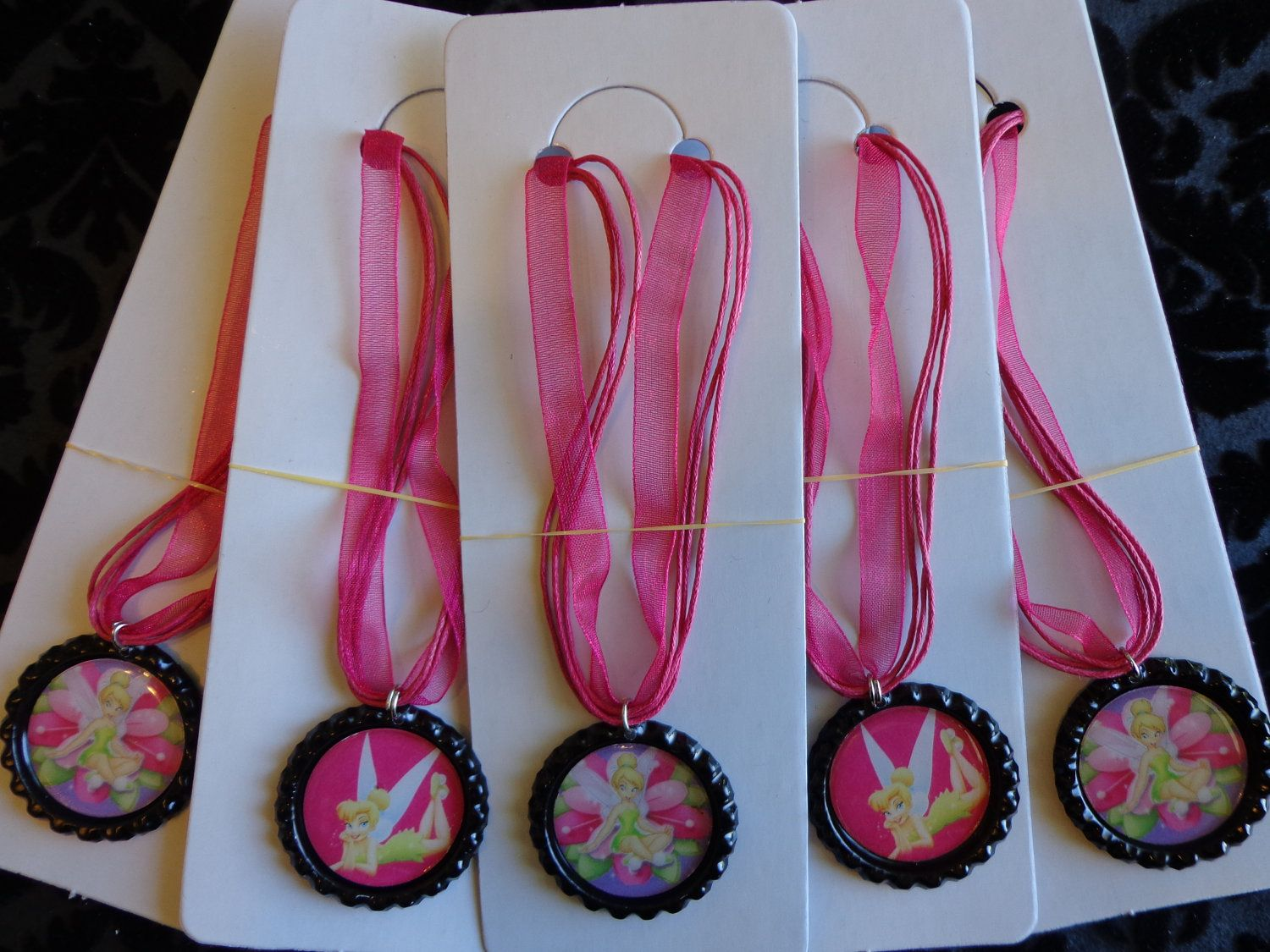 Set of 5 Tinkerbell Party Favor Necklaces. $10.00, via Etsy.