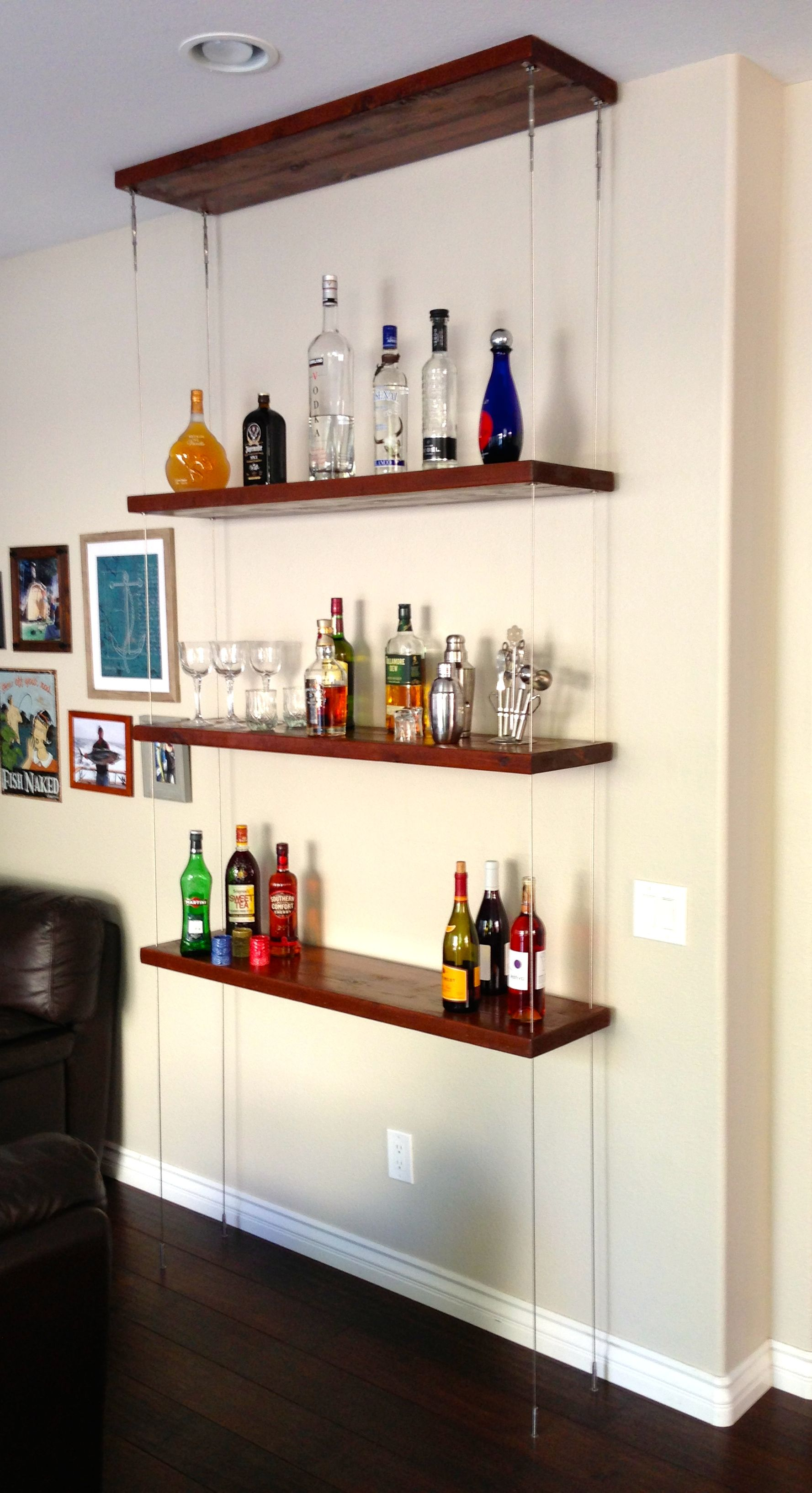 Suspended Shelving Unit Attaches To Ceiling And Floor Using Diy