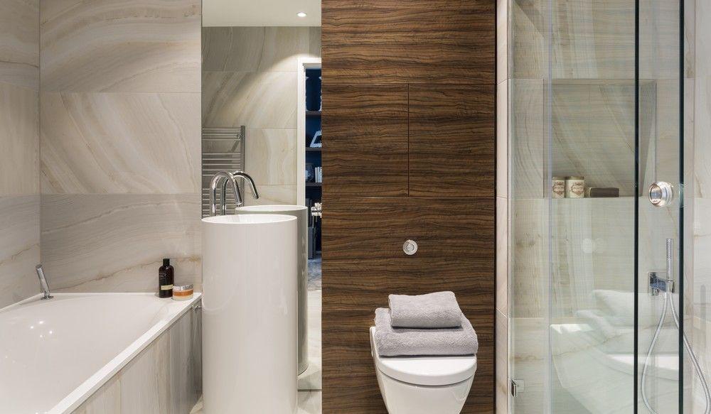 Striking Three Bedroom Duplex Exuding A Vivid Personality In London White Interior Design White Toilet Seats Modern Bathroom Design