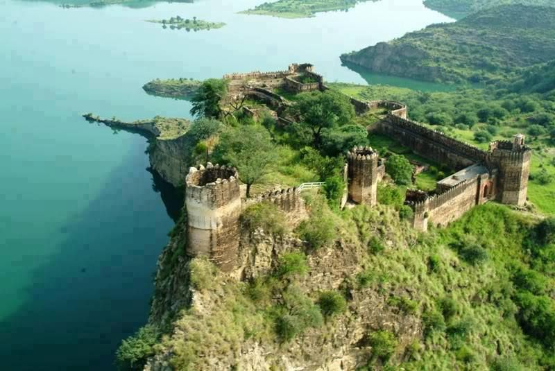 RAMKOT FORT: An ancient fort situated in Azad Kashmir besides Mangla Dam. Accessible through boat; 13KM away from Dina and 79KM road journey from Mirpur.
