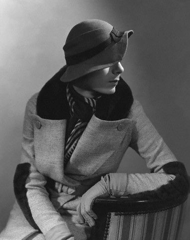 1932 by George Hoyningen-Huene Model is wearing a Rose Descat hat, and a beaver-trimmed coat and scarf, both by Lucien Lelong.
