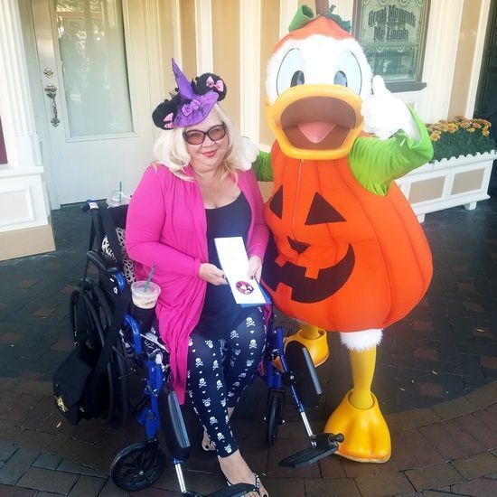 I sported a spooky outfit while hanging out with Donald Duck in this Halloween pic from the past! #skulls #leggings #tunic #flyaway #cardigan #pink #witchhat #minniehat #donaldduck #disneyland #coach #shoes #comfort #wheelchairstyle #chronicfashion #fashion #halloween #ShopStyle #MyShopStyle #Holiday #Travel #Vacation #spookyoutfits I sported a spooky outfit while hanging out with Donald Duck in this Halloween pic from the past! #skulls #leggings #tunic #flyaway #cardigan #pink #witchhat #minnie #spookyoutfits