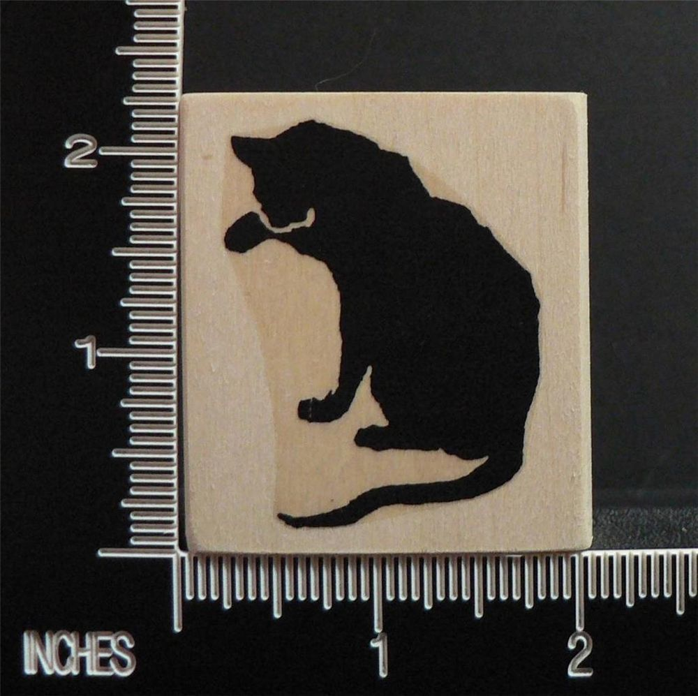 SILHOUETTE OF CAT WASHING ITS FACE rubber stamp BY RUBBERSTAMP AVENUE
