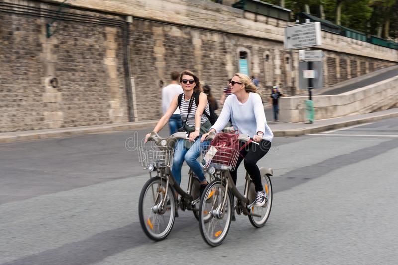 Two Pretty Parisian Girls Who Ride A Velib Two Parisian Bicycle