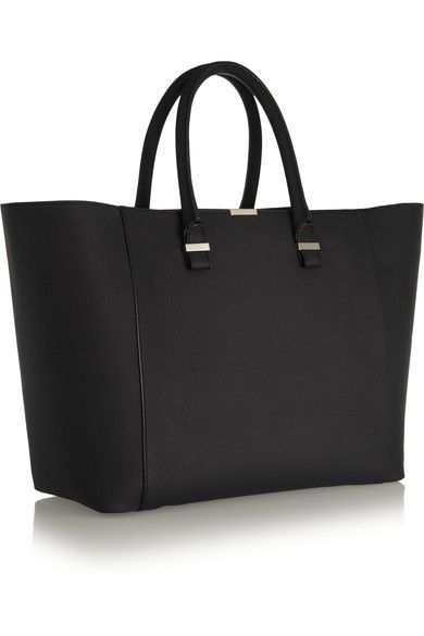 Victoria Beckham's 'Liberty' tote is perfect for overnight business trips. Handcrafted in Italy, it's built to last from sturdy black leather and finished with sleek pale-gold hardware. This timeless style boasts a supremely spacious twill-lined interior complete with zipped and pouch pockets. Fasten the top tab to adjust the shape.