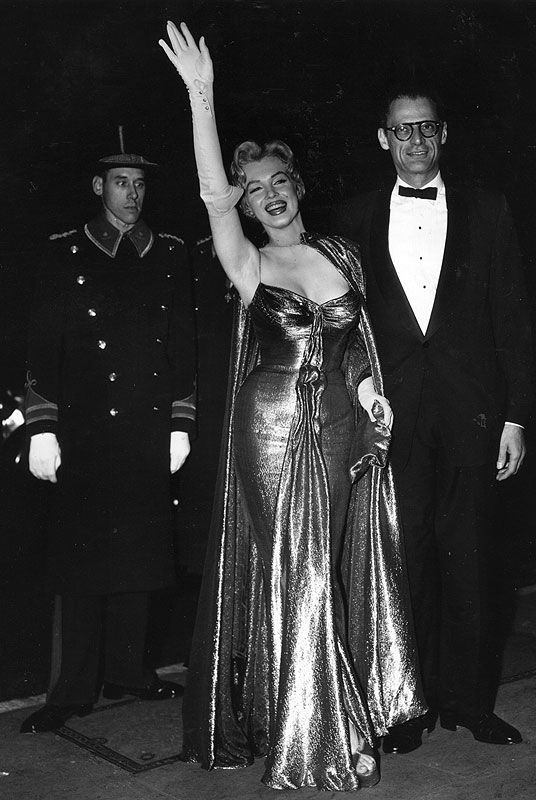 Marilyn And Arthur Miller Arrive At The Empire Theater In London