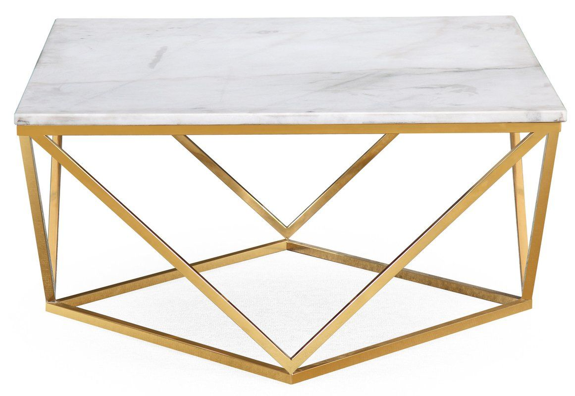 Modern With An Organic Twist This Eye Catching Design Shows Off An Elevated White Marble Top Golden Coffee Table Marble Cocktail Table Geometric Coffee Table [ 800 x 1161 Pixel ]