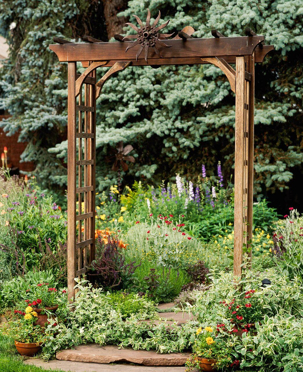20 Gorgeous Arbor Ideas for an Enchanting Outdoor Space is part of Garden arbor, Wooden arbor, Garden arch, Wooden garden, Front yard landscaping, Garden planning - Give your yard a boost of style and added function with a beautiful garden arbor  Whether standing alone or covered with climbing vines and flowers, these outdoor structures add a striking focal point to your yard  These arbor ideas will enhance your garden with charming appeal