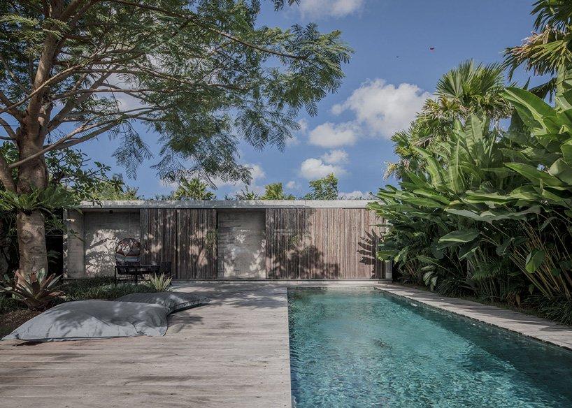 Caceres Tous Sets Exposed Concrete House Bk Amid Bali S Lush Natural Landscape In 2020 Concrete House Sand House Exposed Concrete