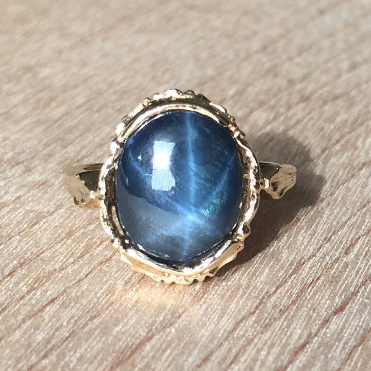 Vintage Ring, Oval Blue Star Sapphire, 10kt Yellow Gold, Beautifully Detailed Floral Band, Gorgeous Detail, Fine Quality, Size 4.5 by RedGingerJewelryCo on Etsy https://www.etsy.com/listing/215563876/vintage-ring-oval-blue-star-sapphire