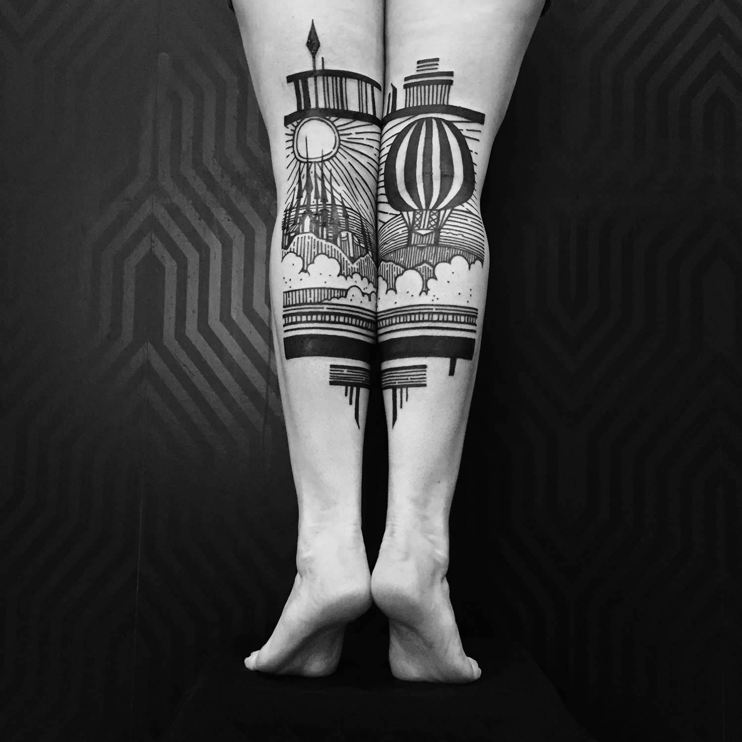 black ink tattoo on legs by thieves of tower