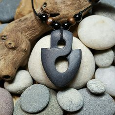 Photo of Items similar to Tribal Arrowhead Necklace hand carved stone pendant mens necklace infinity arrow head primitive jewelry natural stone jewelry rock necklace on Etsy