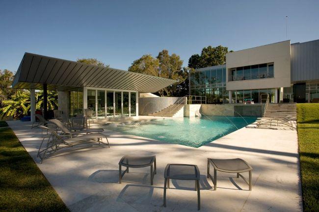 Maison contemporaine avec pool house et piscine minimaliste Pool