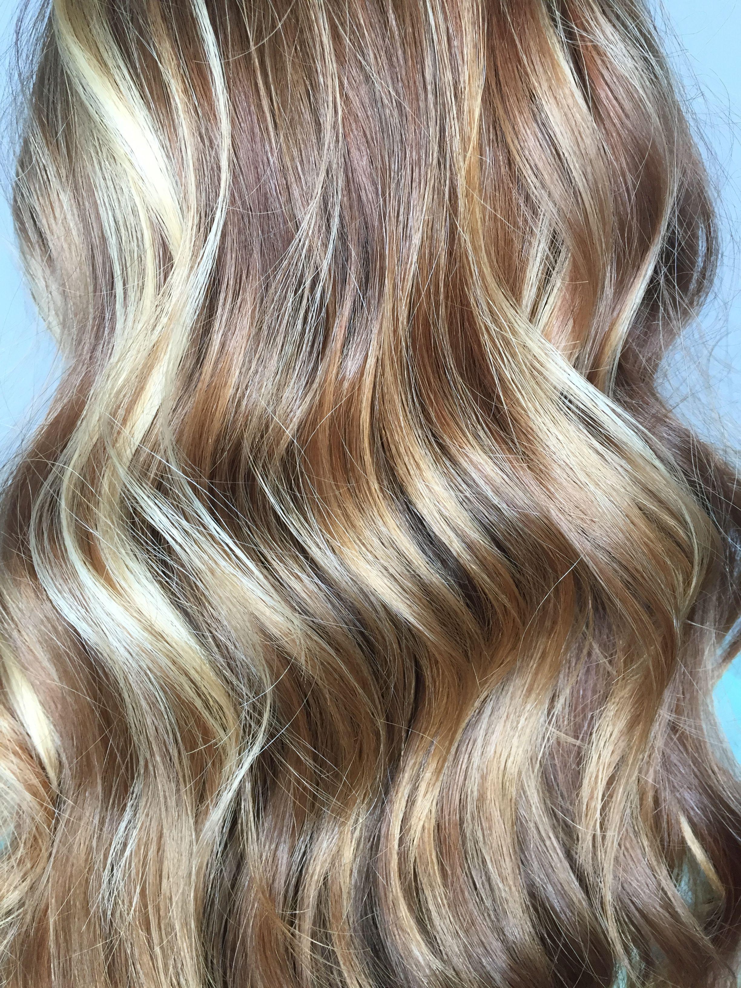 Close Up Wavy Strawberry Blonde Hair With Balayaged Blonde