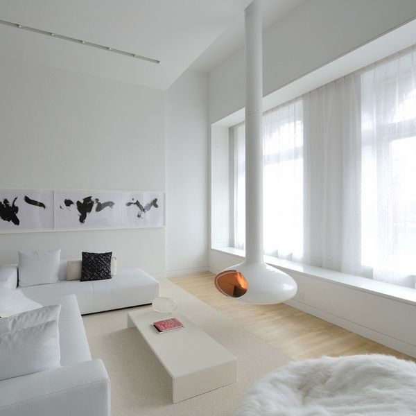 minimalist living room white furniture white hanging fireplace