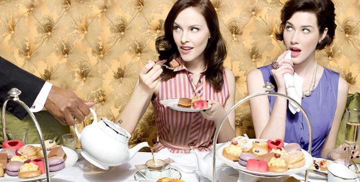 """High Tea is often a misnomer. Most people refer to afternoon tea as high tea because they think it sounds regal and lofty, when in all actuality, high tea, or """"meat tea"""" is dinner. High tea, in Britain, at any rate, tends to be on the heavier side. American hotels and tea rooms, on the other hand, continue to misunderstand and offer tidbits of fancy pastries and cakes on delicate china when they offer a """"high tea.""""  Read more on our blog"""