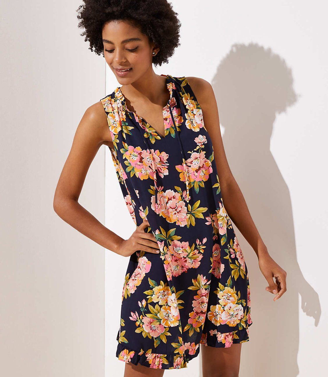 1e8ad88eab38 This swingy floral dress starts with a sweet tie neck and ends with the  flirtiest ruffles