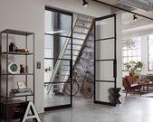 Wooden door with steel look / continuous concrete look floor …