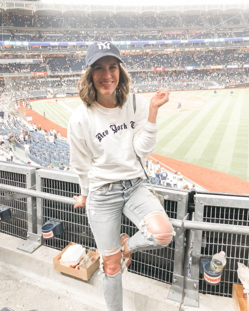 What To Wear To A Baseball Game Easy Your Fav Ripped Jeans And A Vneck Tee Are Always A Safe Bet Grab Y Baseball Game Outfits Gaming Clothes Baseball Outfit