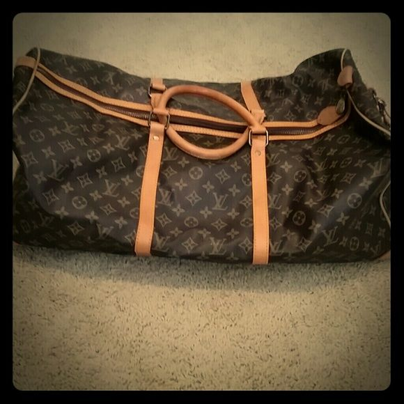 "Louis Vuitton Monogram keepall 55 bandouliere Authentic vintage Louis Vuitton monogram duffle. Great condition. Measures 22"" in length 10"" width 12"" height. Lost the long strap Louis Vuitton Accessories"