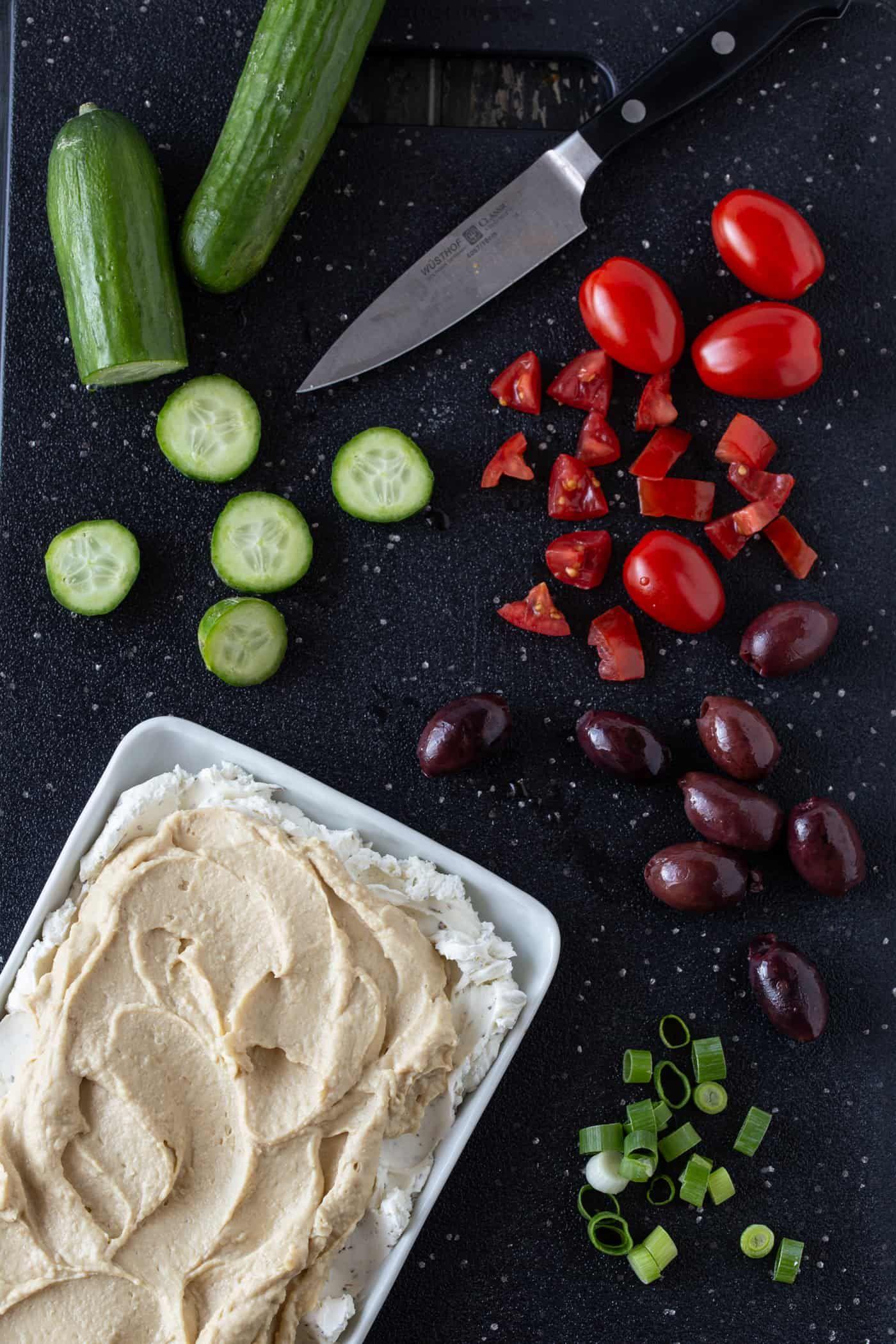 Layered Greek Dip (a Mediterranean 7-layer dip!) - Garnish with Lemon